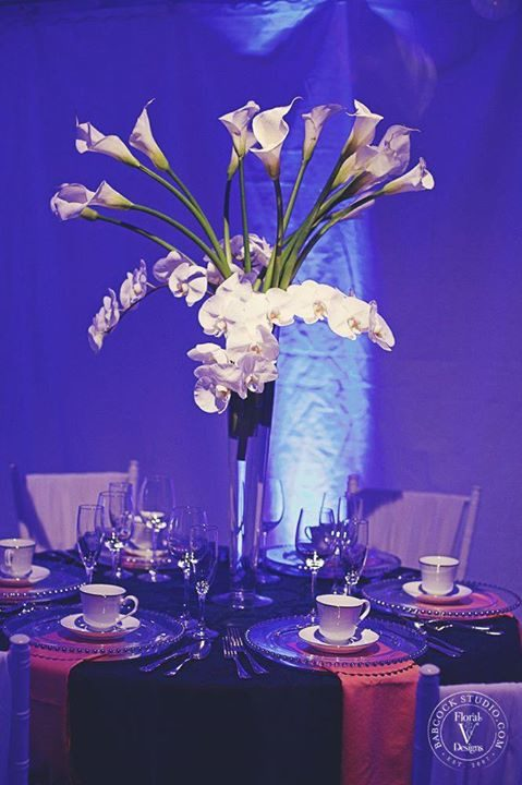 tall white wedding centerpiece with orchids